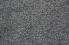 Closeup surface fabric pattern at the old black fabric trousers textured background Royalty Free Stock Image