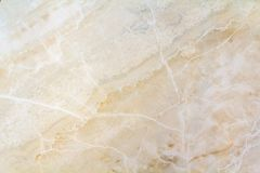 Closeup surface of marble pattern at the marble floor texture ba. Ckground , yellow abstract marble pattern Royalty Free Stock Image