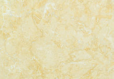 Closeup surface marble pattern at the yellow marble stone wall texture background Royalty Free Stock Image