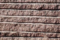 Closeup of surface reddish granite block Royalty Free Stock Image