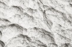 Closeup surface of stone pattern at big rock for decoration in the garden textured background in black and white tone. Closeup surface stone pattern at big rock Royalty Free Stock Image