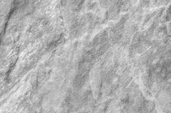 Closeup surface at stone pattern at stone brick wall in the garden textured background in black and white tone. Closeup surface stone pattern at stone brick wall Royalty Free Stock Photos