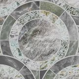 Closeup surface tile circle pattern by mix of color marble stone. Closeup surface black tile circle pattern at marble stone floor textured background stock images