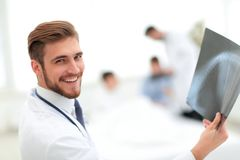 Closeup.surgeon examining an x-ray. Photo with copy space Royalty Free Stock Image