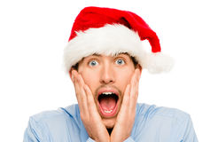 Closeup of surprised businessman wearing christmas hat isolated Stock Photography