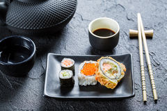 Closeup of sushi on the black ceramic dish Royalty Free Stock Photography