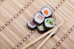 Closeup sushi and chopsticks on bamboo mat Stock Photography