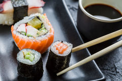 Closeup of sushi eaten with chopsticks Royalty Free Stock Photo