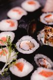 Closeup Sushi nigiri and rolls served on brown wooden table in plate. Healthy asian food. Macro photography Stock Photos