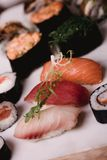 Closeup Sushi nigiri and rolls served on brown wooden table in plate. Healthy asian food. Macro photography Stock Images