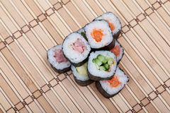 Closeup sushi roll on bamboo mat Stock Photography