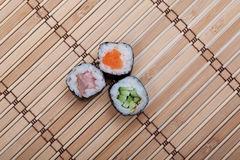 Closeup sushi roll on bamboo mat Royalty Free Stock Photo
