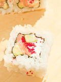 Closeup of a sushi roll on the desk Royalty Free Stock Photos