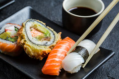 Closeup of sushi served in the dark ceramics Royalty Free Stock Photos
