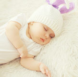 Closeup sweet baby sleeping at home on the bed. Top view Stock Photos