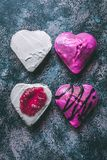 Closeup of sweet tasty and creamy edible hearts with jello on a rustic grungy background stock image