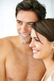 Closeup of a sweet young couple looking away Stock Photo