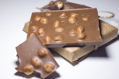 Closeup of sweets, chocolate with nuts on a white background. stock photo