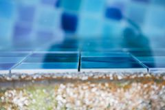 Closeup swimming pool damage by acid water eating out grouting. Pool problem Royalty Free Stock Image