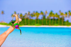 Closeup swimsuit on background of turquoise water Royalty Free Stock Photography