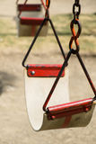 Closeup of swing in a children play area at park Royalty Free Stock Photo