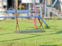 Closeup of swings in a children play area Royalty Free Stock Photo