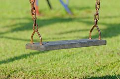 Closeup of swings in a children play area Stock Photos