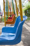 Closeup of swings in a playground Royalty Free Stock Image