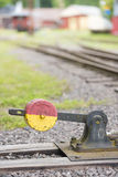 Closeup of switch by train tracks Stock Photo