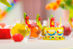 Closeup on table decorated for baby birthday party Royalty Free Stock Photo