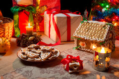 Closeup of a table set with Christmas gifts Royalty Free Stock Images