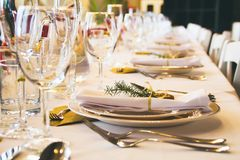 Closeup table setting in restaurant. royalty free stock photography