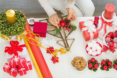 Closeup on table where woman making decorationsr Royalty Free Stock Photos