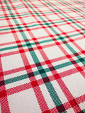 Closeup of Tablecloth with checkered pattern on white background. Closeup of Tablecloth with checkered pattern, white background with red and green lines Stock Image
