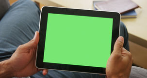 Closeup of tablet with greenscreen. Closeup of man holding tablet with greenscreen Stock Images