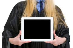 Tablet pc in hand of woman in graduation gown Royalty Free Stock Photos