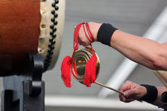 Closeup of a Taiko Drummer Playing Bells Stock Images