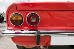 Closeup of the tail lights of car. Closeup of the tail ights of a red classic car stock image