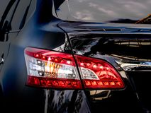 Closeup of a taillight on a modern car. Black color stock image