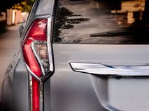 Closeup of a taillight on a modern car. Sunset light stock image