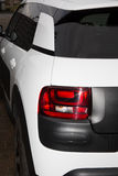 Closeup of a taillight on a modern car white and black Royalty Free Stock Images