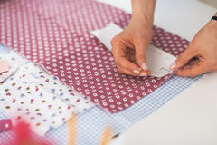 Closeup on tailor woman working with fabric Royalty Free Stock Photos