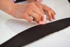 Closeup on tailor woman working with fabric Stock Photos