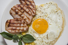 Closeup of tasty bacon and fried eggs Stock Images