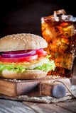Closeup of tasty burger with cold drink Stock Photography