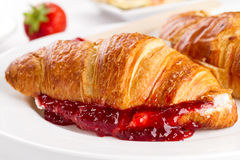 Closeup of tasty fresh appetizing croissants with fruit jam, cot Stock Image