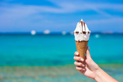 Closeup of tasty ice cream background the turquoise sea Stock Photos