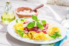 Closeup of tasty pappardelle pasta with tomato and parmesan Stock Photos