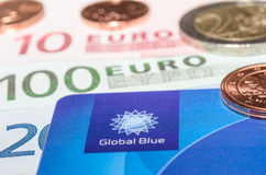 Closeup Tax Free plastic card from company Global Blue banknotes Royalty Free Stock Image