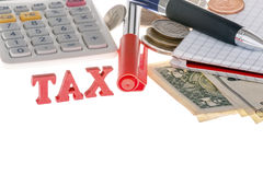 Closeup of tax sign, calculator, marker, banknotes, coins and pa Stock Image